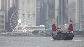 HONG KONG - DEC 23 2016 : Chinese Junk Boat Motors across Hong Kong Harbour. 4K Video stock video footage