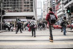 People walks across the street, Causeway Bay in Hong Kong royalty free stock photo