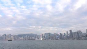 HONG KONG - DEC 23 2016 : Star Ferry is sailing through Victoria Harbour, with the skyline of Hong Kong as backdrop. 4K Video stock footage