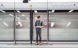 Lost traveler looks at a tourist map on subway MTR station in Hong Kong stock images