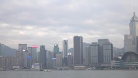 HONG KONG - DEC 23 2016 : Victoria Harbour, with the skyline of Hong Kong as backdrop. 4K Video stock footage