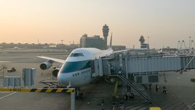 A Cathay Pacific Boeing 747-400 parks at the departure gate in Hong Kong International Airport stock photos