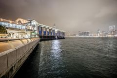 Hong Kong city ferry terminal building at night stock image