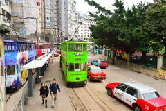 Double-decker tramway. HONG KONG - DECEMBER 25, 2015: view from upper deck of double-decker tramway. The tram is the cheapest mode of public transport on Hong Stock Photography
