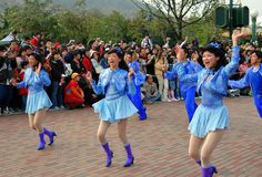 Hong Kong: Disneyland Grand Parade. Crowds line the streets at the Hong Kong Disneyland theme park to witness the daily Grand Parade featuring hundreds of park Stock Photo