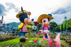 HONG KONG DISNEYLAND: Mickey and minnie in love at the park in front of the castle Stock Images