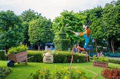 Goofy is decorating his garden at Hong Kong Disneyland. HONG KONG DISNEYLAND: Goofy is decorating his garden at Hong Kong Disneyland Stock Image