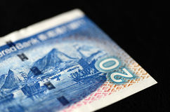20 Hong Kong-Dollar auf einem dunklen Hintergrund Lizenzfreie Stockbilder