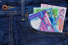 Hong Kong Dollar currency in Jean's pocket. Financial and Banking Royalty Free Stock Photo