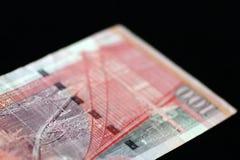 100 Hong Kong dollar på en mörk bakgrund Royaltyfri Foto