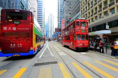 Hong Kong Double-Decker Tram picking up passenger Stock Image