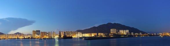 Hong Kong downtown along coast at night Stock Images