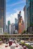 Hong Kong Downtown gata som trängas ihop med transport Royaltyfri Foto