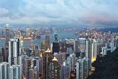 Hong Kong at dusk. View of Hong Kong skyline and Victoria Harbour from Victoria Peak royalty free stock photo