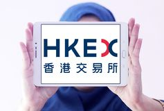 Hong Kong Exchanges and Clearing, HKEX logo. Logo of Hong Kong Exchanges and Clearing, HKEX on samsung tablet holded by arab muslim woman. It operates a stock Stock Images