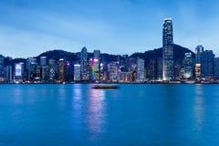 HONG KONG - FEB 19, 2014: Night view of Hong Kong at February 19, 2014. Night view of Hong Kong skyline from Tsim Sha Tsui Promenade, Kowloon, Hong Kong at royalty free stock image