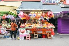 HONG KONG- FEBRUARY 19, 2018-Kawloon - Fruits vendors selling ve. Rity of fruits on street market stalls of Hong Kong,  the seasonal fruits are fresh and Royalty Free Stock Images