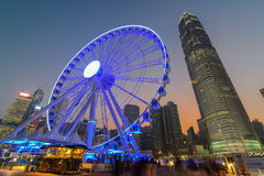 Hong Kong Ferris Wheel with IFC building. Hong Kong, China - September 27, 2014: Hong Kong observation wheel will look when it is finally opened in Oct, 2014, it Royalty Free Stock Image