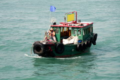 Hong Kong fisherman boat. Victoria Bay Royalty Free Stock Photography