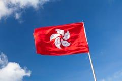 Hong Kong flag over blue cloudy sky Stock Image