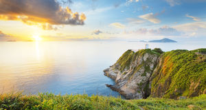 Hong Kong fyr under soluppgång Arkivfoto