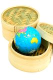 Hong Kong Global Business. Two bamboo steaming baskets for dim sum with a world globe in one of the baskets - a metaphor for Hong Kong's financial and business royalty free stock images
