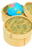 Hong Kong Global Business. Two bamboo steaming baskets for dim sum with a world globe in one of the baskets - a metaphor for Hong Kong's financial and business stock photo
