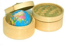 Hong Kong Global Business. Two bamboo steaming baskets for dim sum with a world globe in one of the baskets - a metaphor for Hong Kong's financial and business Stock Image