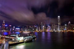 Hong Kong Harbor at Night from Kowloon Ferry Stock Photo