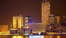 Hong kong harbor skylines. View of kowloon hong kong harbor skylines at night as viewed from wan chai promenade Royalty Free Stock Photography