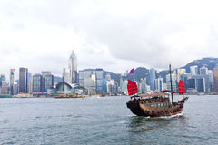 Hong Kong harbor with tourist junk boat Stock Images