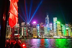 Hong Kong harbor view from traditional junk boat at night during famous laser show. Travel in China, Asia. Sailing on historical. Ship in Hong Kong Victoria royalty free stock image