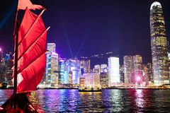 Hong Kong harbor view from traditional junk boat at night during famous laser show. Travel in China, Asia. Sailing on historical. Ship in Hong Kong Victoria stock photos
