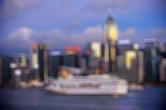Hong Kong Harbour at sunset, blur bokeh light. Stock Photo