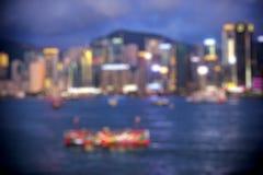 Hong Kong Harbour at sunset, blur bokeh light Royalty Free Stock Photo