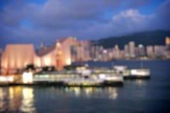 Hong Kong Harbour at sunset, blur bokeh light Royalty Free Stock Photography