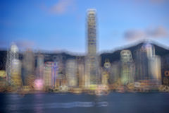 Hong Kong Harbour at sunset, blur bokeh light Royalty Free Stock Image