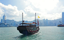 Hong Kong harbour with tourist junk. Boat Royalty Free Stock Photos