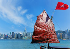 Hong Kong harbour with tourist junk Royalty Free Stock Photo