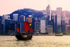 Hong Kong cityscape at Victoria Harbour and Tourist junk boat. Tourist junk boat in the morning at Victoria harbour , Hong Kong stock photos