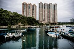 Hong Kong high rise buildings and fishing village stock images