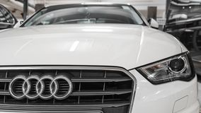 Hong Kong, Hong Kong - 25 April 2018: Close-up of Audi logo badge, headlights and car grill on a white Audi S3 hatchback car. Royalty Free Stock Images