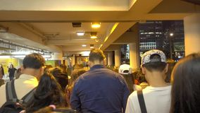 People are boarding the Hong kong star ferry from the Central Pier. stock video footage