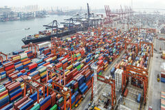 Hong Kong industrial containers on the wharf. Industrial port with containers in Hong Kong Stock Image