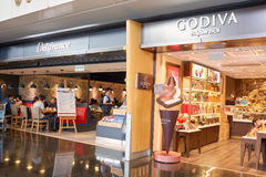 Hong Kong International Airport. HONG KONG - CIRCA NOVEMBER, 2016: Delifrance Godiva at Hong Kong International Airport. It is the main airport in Hong Kong. The Royalty Free Stock Photography