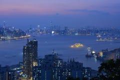 Hong Kong Island and kowloon night scene. Night scene of Hong Kong Island and kowloon, taken from Devil`s Peak Stock Photo