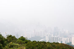 Hong Kong island obscured by haze Royalty Free Stock Photo