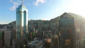 Hong Kong - JAN 22: Aerial golden sunset skyscrappers city view. Beautiful sunburst reflection on big building windows. stock video