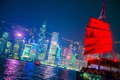 Hong Kong - January 10, 2018 :Chinese wooden sailing ship with r. Ed sails in Victoria harbor at Hong Kong Island, landmark Royalty Free Stock Photography