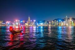 Hong Kong - January 10, 2018 :Chinese wooden sailing ship with r. Ed sails in Victoria harbor at Hong Kong Island, landmark Stock Images